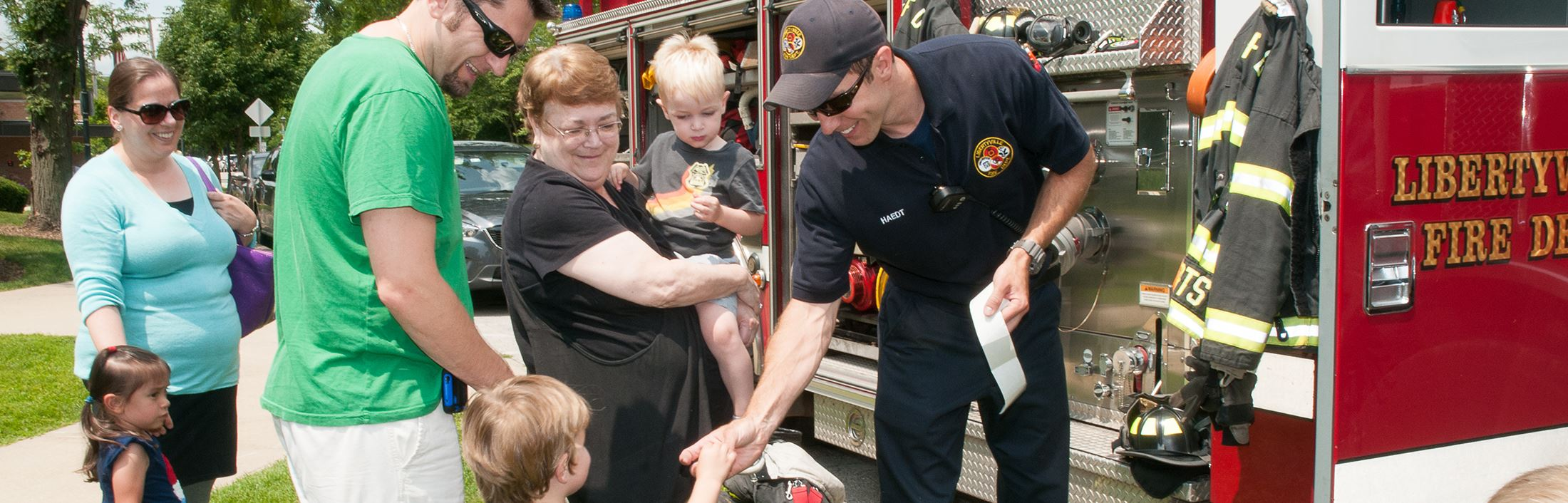Fire Fighter Giving Sticker to Child